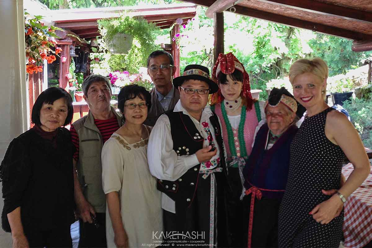 With Japanese tourists who are wearing Hungarian traditional Paloc costume in Hollókő